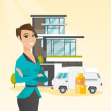 Young caucasian woman moving to a house. Stock Photos