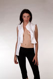 Young caucasian woman open white shirt black pants Stock Photo