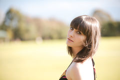 Young caucasian woman in a park with soft light Royalty Free Stock Photos