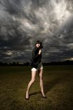 Young caucasian woman in a park with stormy sky royalty free stock photos