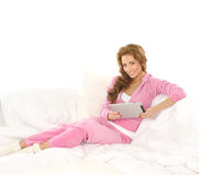 A young Caucasian woman in pink sporty clothes Royalty Free Stock Photography