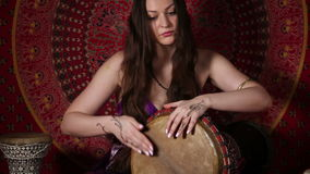 Young Caucasian woman playing the drum stock video