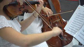 Young caucasian woman plays violin stock footage