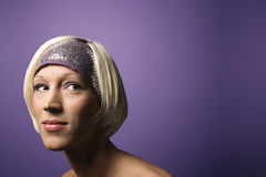 Young Caucasian woman portrait. Head and shoulder portrait of bare young adult Caucasian blond woman on purple background wearing headband Stock Photos