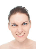 Young caucasian woman portrait isolated. Young caucasian woman portrait with an evil mockery sarcastic smile facial expression, isolated over the white Stock Image