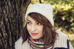 Young caucasian woman posing in autumn nature, seasonal fashion. Young youful caucasian woman posing in autumn nature. Seasonal fashion. Female portrait. Vibrant stock photo
