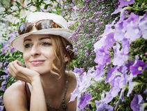 Young caucasian woman posing with beautiful flowers Royalty Free Stock Photography