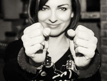 Young caucasian woman posing with handcuffs at the party, black royalty free stock photography