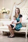 Young Caucasian woman posing with little son Royalty Free Stock Photos