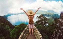 Woman feeling free travelling the world stock image