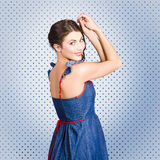 Young caucasian woman posing in retro denim dress Stock Image