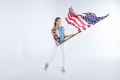 Young caucasian woman posing and waving USA flag Royalty Free Stock Photo