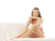 A young Caucasian woman posing in white lingerie Royalty Free Stock Image