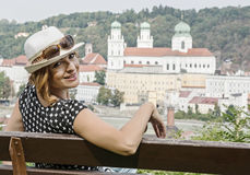 Young caucasian woman posing on the wooden bench with Saint Step Royalty Free Stock Images