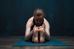 Young caucasian woman practicing yoga on blue mat stock photos