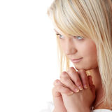 Young caucasian woman praying. Closeup portrait of a young caucasian woman praying isolated on white background Royalty Free Stock Photo