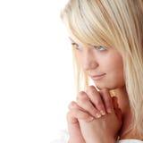 Young caucasian woman praying Royalty Free Stock Photo
