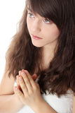 Young caucasian woman praying Royalty Free Stock Image