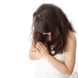 Young caucasian woman praying Royalty Free Stock Photos