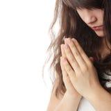 Young caucasian woman praying. Closeup portrait of a young caucasian woman praying isolated on white background stock photos