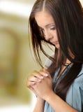 Young caucasian woman praying. Closeup portrait of a young caucasian woman praying Stock Photography