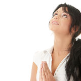 Young caucasian woman praying Stock Photos