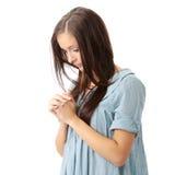Young caucasian woman praying Stock Photography