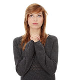 Young caucasian woman praying. Closeup portrait of a young caucasian woman praying isolated on white background Royalty Free Stock Photos
