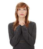 Young caucasian woman praying Royalty Free Stock Photos
