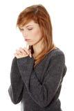 Young caucasian woman praying Stock Photo