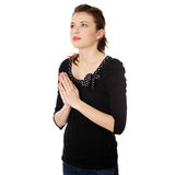 Young caucasian woman praying Stock Photo
