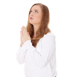Young caucasian woman praying. Closeup portrait of a young caucasian woman praying , isoalted on white Royalty Free Stock Images