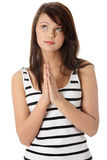 Young caucasian woman praying. Closeup portrait of a young caucasian woman praying isolated on white background Royalty Free Stock Photography