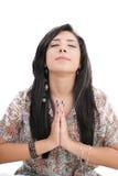 Young caucasian woman praying. Closeup portrait of a young caucasian woman praying stock photo