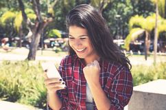Young caucasian woman receiving good news on phone stock photo