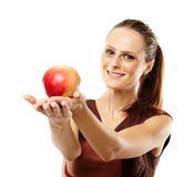 Young caucasian woman with red apple Royalty Free Stock Images