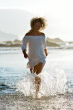 Young caucasian woman refreshing on the beach Royalty Free Stock Photo