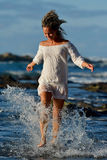 Young caucasian woman refreshing on the beach in summer Stock Photo