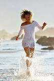Young caucasian woman refreshing on the beach in summer Royalty Free Stock Images
