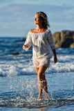 Young caucasian woman refreshing on summer evening Stock Images