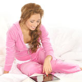 A young Caucasian woman relaxing in pink clothes Stock Photo
