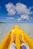 Young caucasian woman rests at beach near kayak Stock Photos