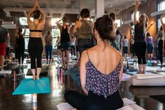 Diverse group of people in yoga class.