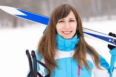 Young caucasian woman with ski at snowy winter day. Royalty Free Stock Photos