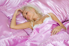 Young caucasian woman sleep in bed Stock Images