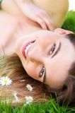 Young caucasian woman smiling outdoors with flowers Stock Images