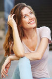 Young caucasian woman smiling outdoors and looking away Stock Images