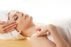 A young Caucasian woman on a spa procedure Stock Photography