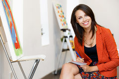 Young caucasian woman standing in art gallery Royalty Free Stock Photos
