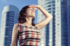 Young caucasian woman standing in city looking away. Stock Photos